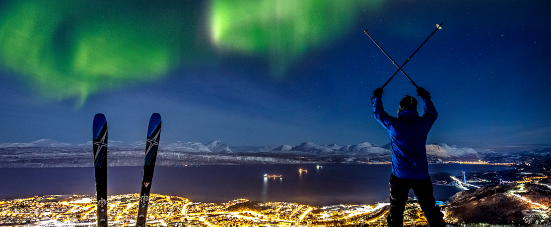 Narvik city and aurora borealis